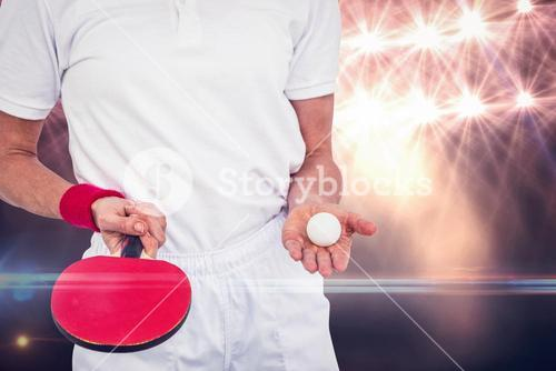 Composite image of male athlete holding ping pong ball and paddle