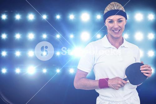 Composite image of female athlete holding a paddle
