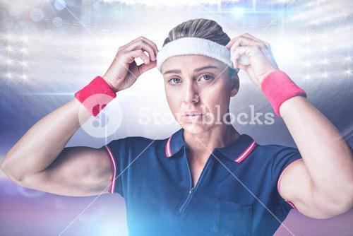 Composite image of female athlete adjusting her headband