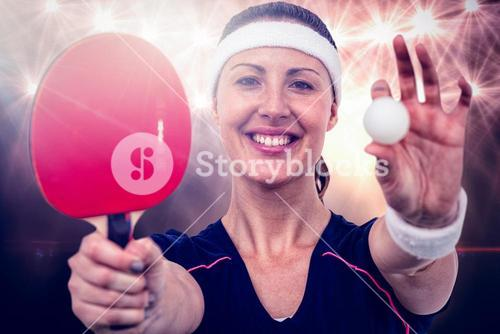 Composite image of female athlete holding table tennis paddle and ball