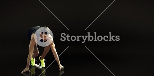 Composite image of sportsman waiting on the starting block