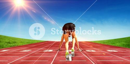 Composite image of sportsman in starting block
