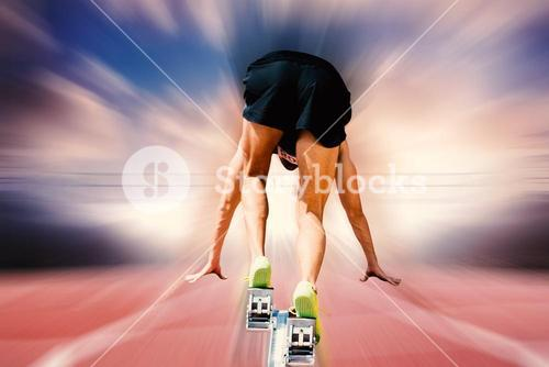 Composite image of sportsman on starting blocks