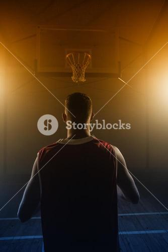 Portrait of basketball player front the back in front of a basket