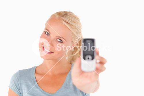 Happy woman showing a mobile