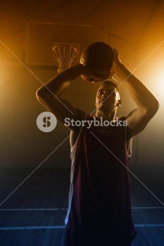 Portrait of basketball player trying to scoring