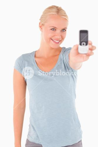 Smiling gorgeous woman showing a phone