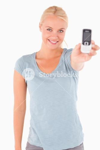 Smiling cute woman showing a phone