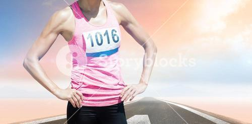 Composite image of sportswoman chest is posing with hands on hips
