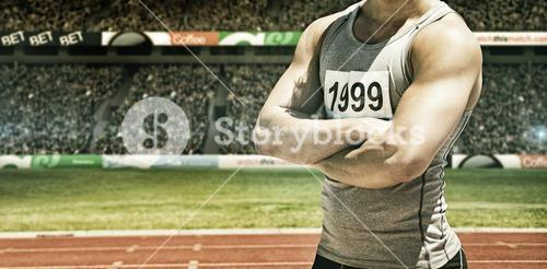 Composite image of handsome sportsman is posing with crossed arms