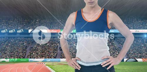 Composite image of female athlete standing with hand on hip