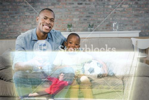 Composite image of cute father and son are posing in front of sport match on television