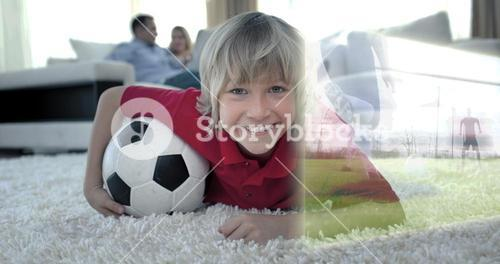 Composite image of cute soccer fan is watching soccer match on television