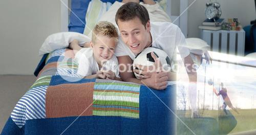 Composite image of father and son are watching sport on television