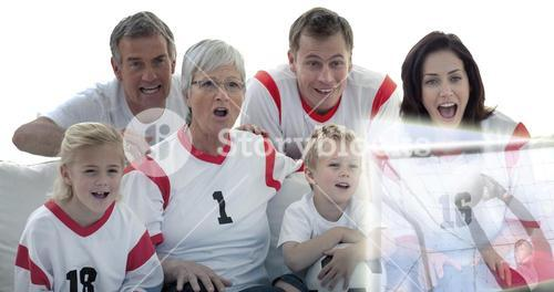 Composite image of excited family watching a football match in television