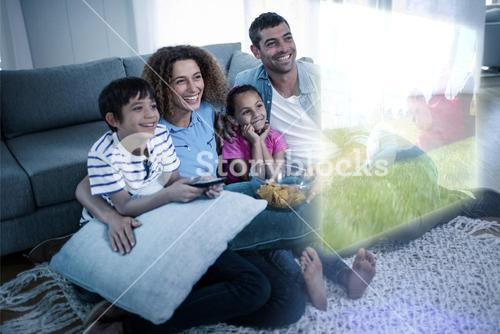 Composite image of family are watching sport on television