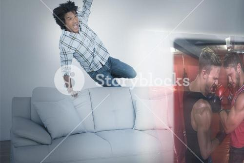 Composite image of excited man are watching boxing match on television