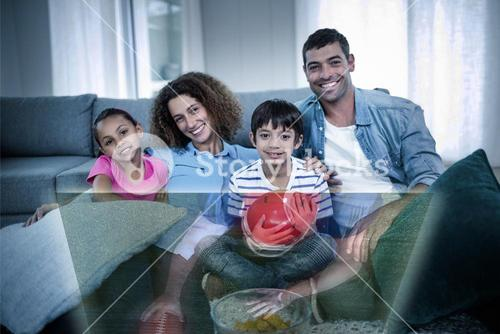 Composite image of family is watching sport on television