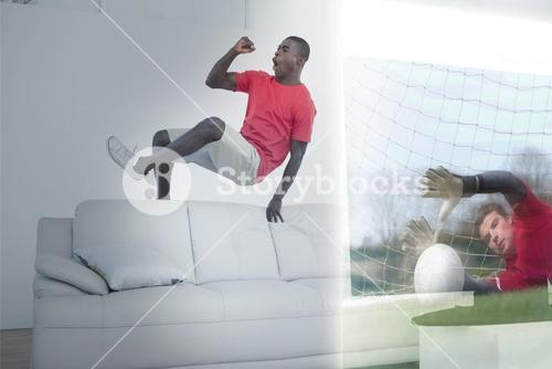 Composite image of excited man is watching sport match on television