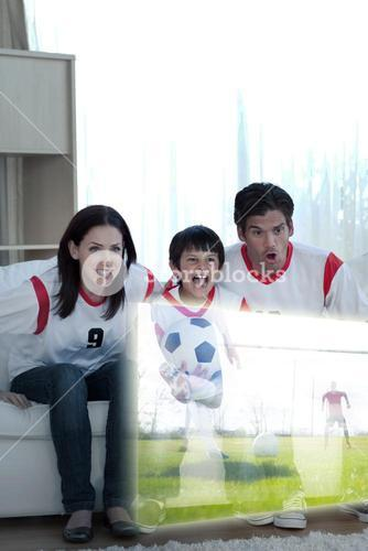 Composite image of animated family watching a football match