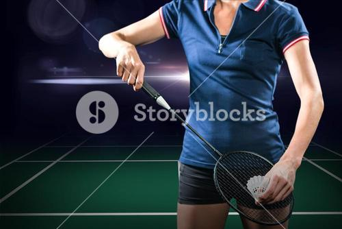 Composite image of badminton player holding a racket ready to serve