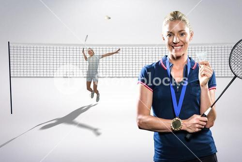 Composite image of badminton player posing with a medal