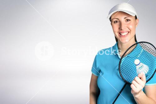Composite image of badminton player holding badminton racket and shuttlecock
