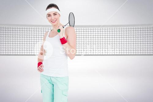 Composite image of badminton player is posing and smiling