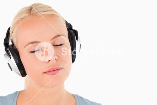 Portrait of a woman with headphones having eyes closed