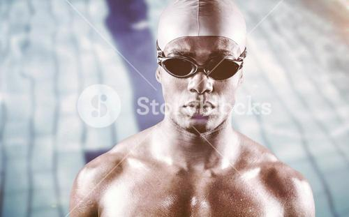 Composite image of serious swimmer posing with swimming equipment