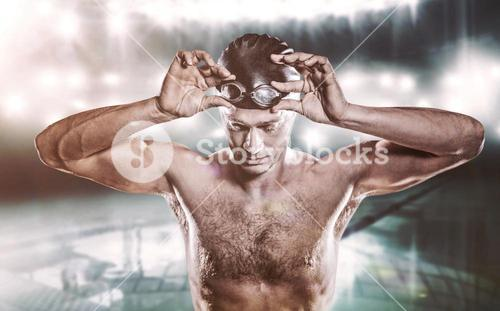 Composite image of swimmer holding swimming goggles