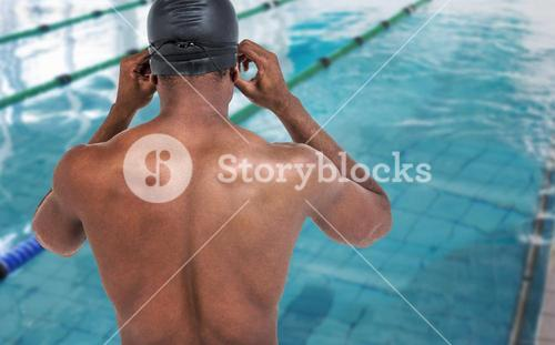 Composite image of rear view of swimmer in shirtless wearing swimminggoggles