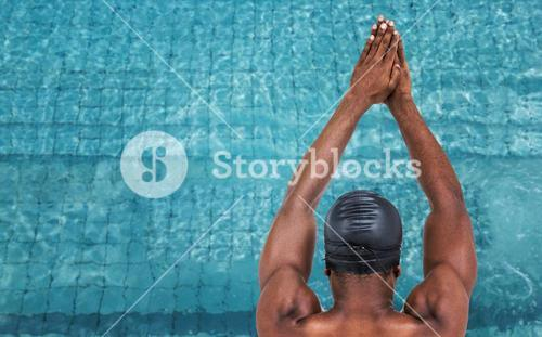 Composite image of rear view of swimmer ready to dive