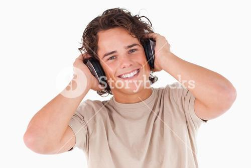 Smiling man with headphones looking into the camera