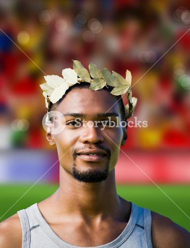 Composite image of portrait of victorious sportsman with crown of laurels