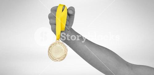 Athlete holding gold medal after victory