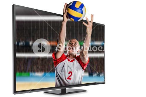 Composite image of sportsman catching a volleyball while playing