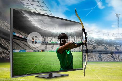 Composite image of rear view of sportsman doing archery on a white background