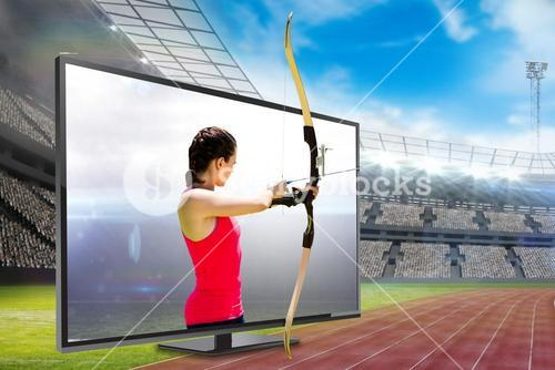 Composite image of side view of woman practicing archery