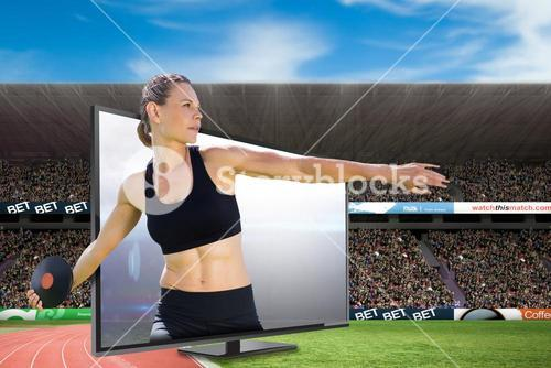 Composite image of concentrated sportswoman practising discus throw
