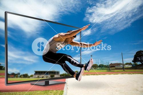 Composite image of portrait of sportsman jumping