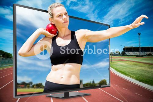Composite image of front view of sportswoman practising shot put