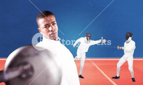 Composite image of swordsman practicing with fencing sword
