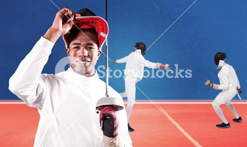 Composite image of portrait of swordsman standing with fencing mask and sword