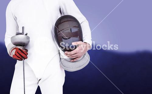 Composite image of swordsman holding fencing mask and sword