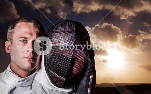 Composite image of close-up of swordsman holding fencing mask