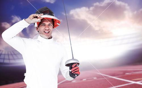 Composite image of man wearing fencing suit practicing with sword