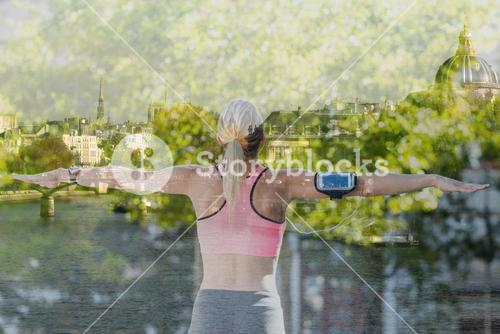 Composite image of a beautiful athlete stretching her arms