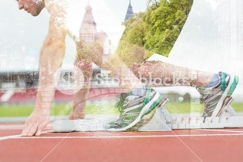 Composite image of side view of a man ready to race on running trac