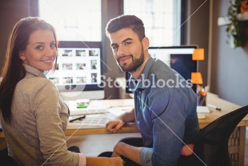 Graphic designers working at desk in the office